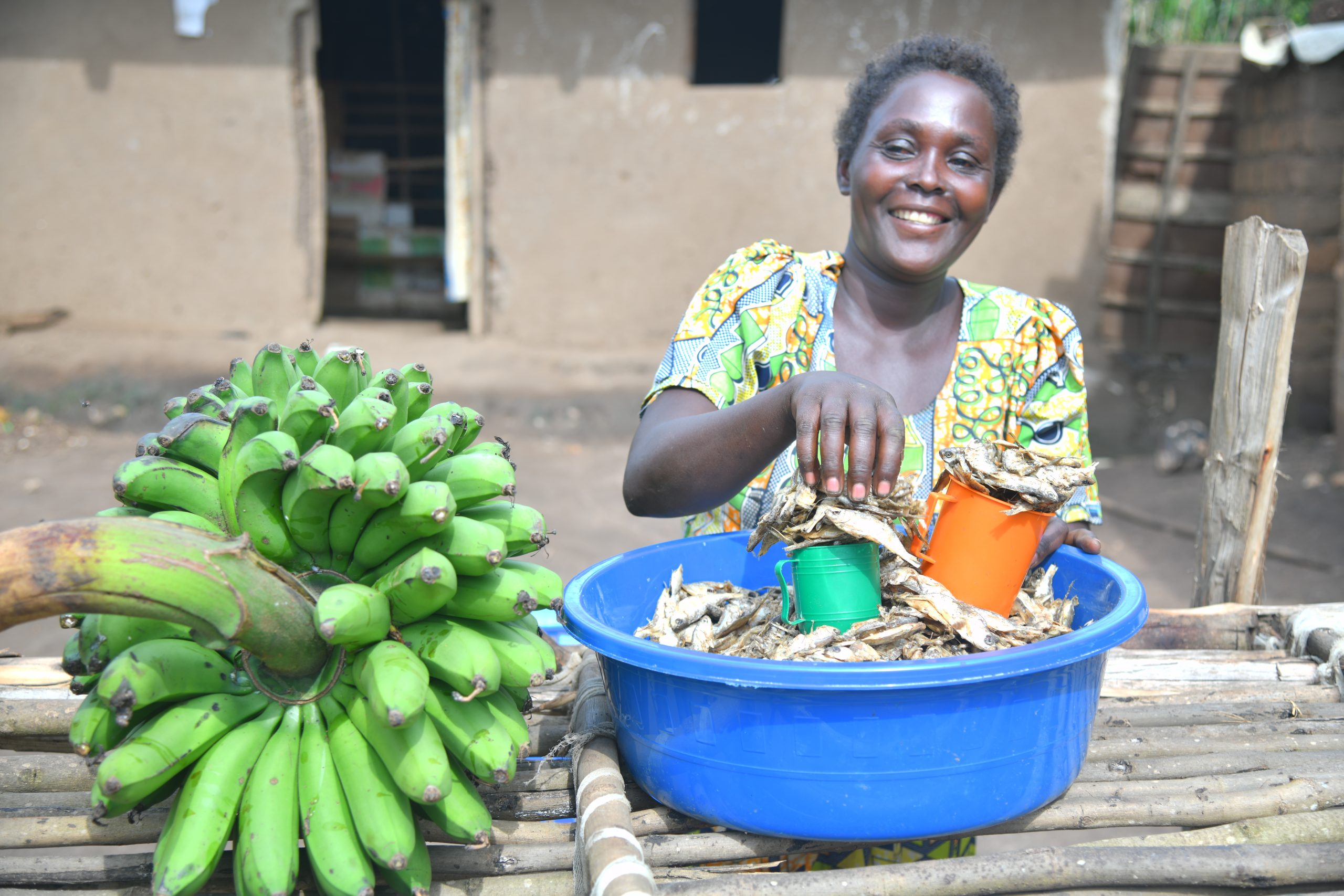 Petronia displays some of the food she produces and sells in the refugee settlement during the COVID-19 pandemic